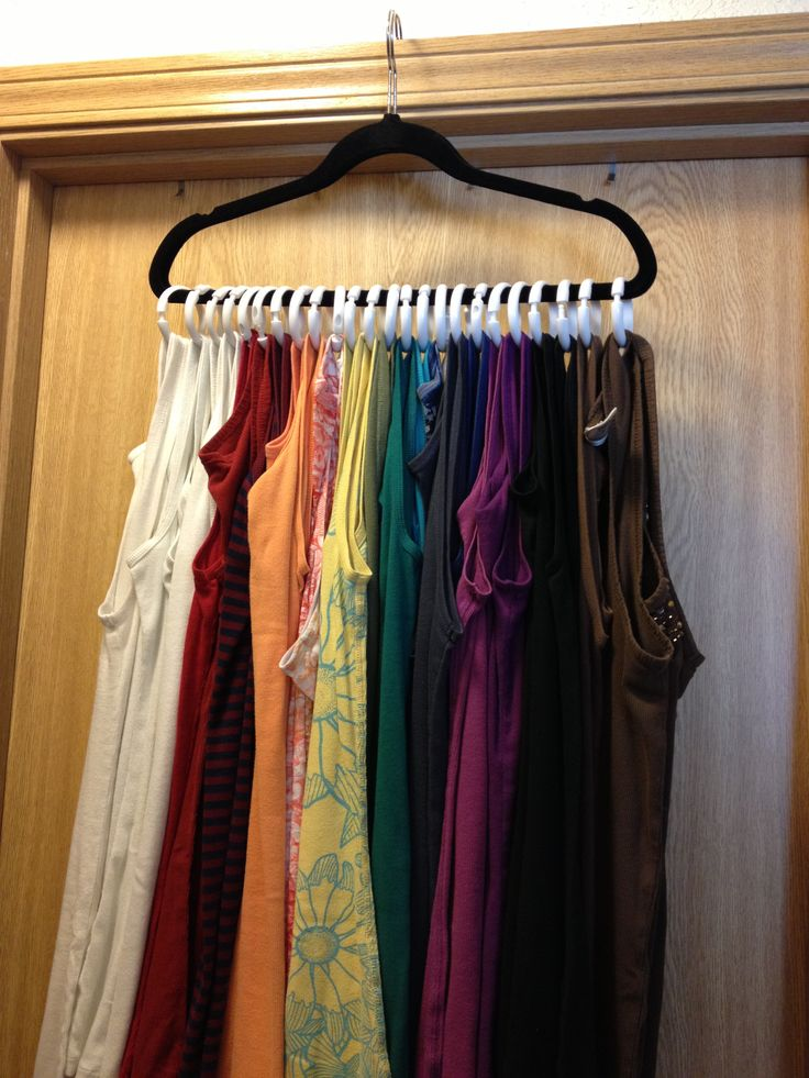 TANK TOP SPACE SAVER – Picked up a few curtain rings from the dollar store….and viola! All your tanks now neatly organized on one hanger.